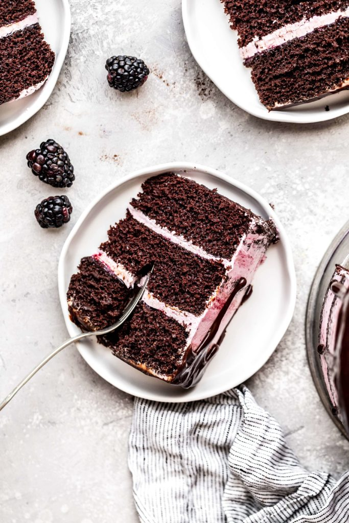 a slice of chocolate blackberry cake on a plate