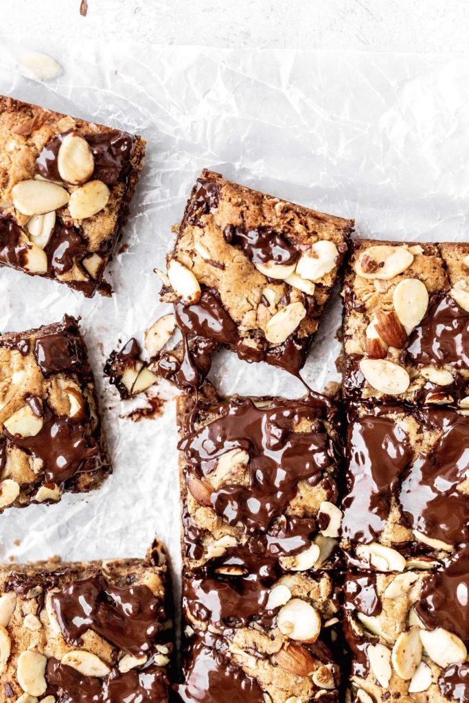 almond chocolate chip cookie bars being pulled away from the rest