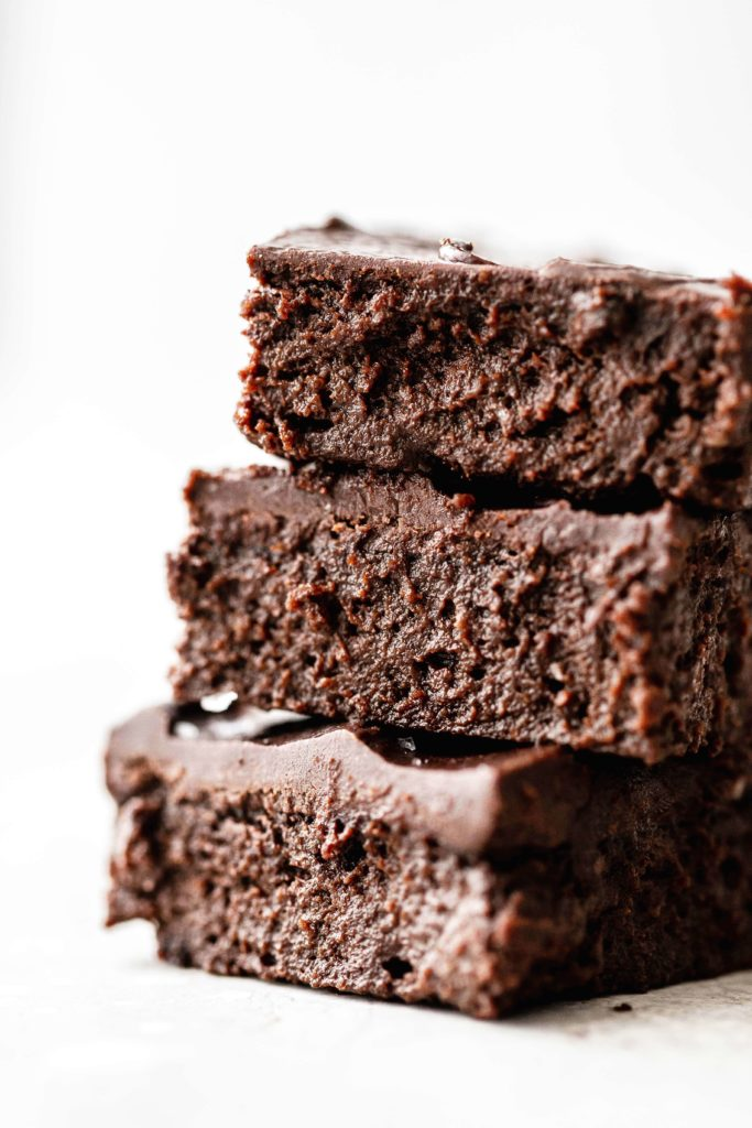 a stack of three sweet potato brownies