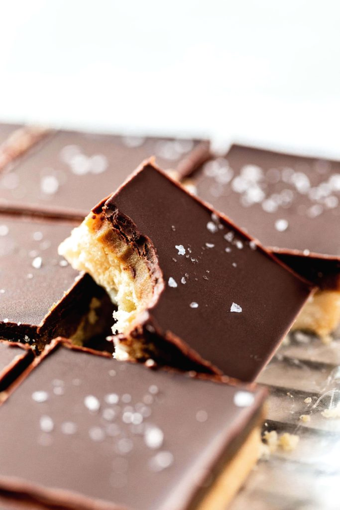 a bite taken out of a millionaire shortbread bar
