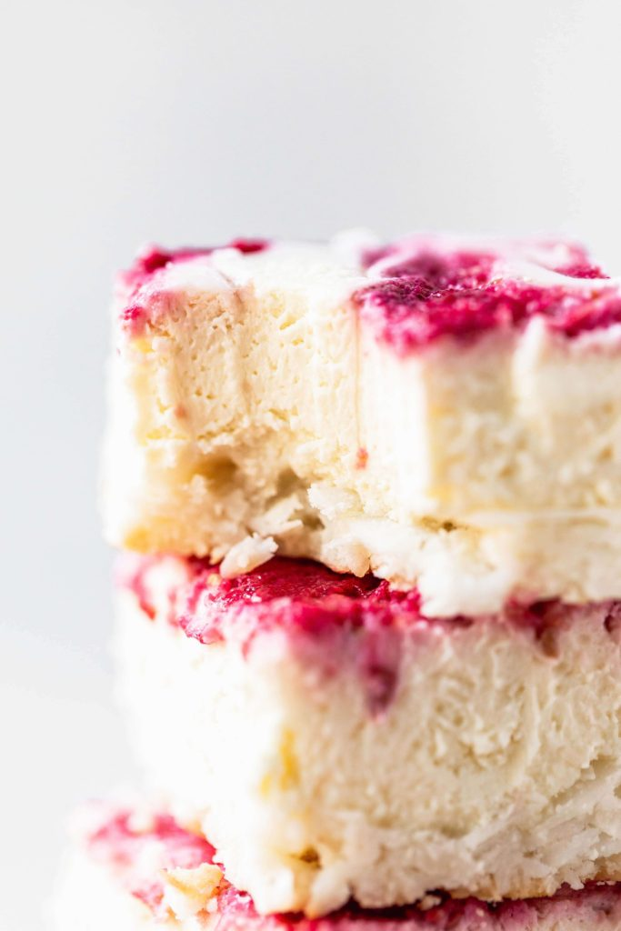 a stack of low carb raspberry cheesecake bars