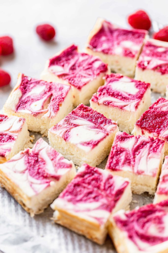 a tray of low carb raspberry cheesecake squares