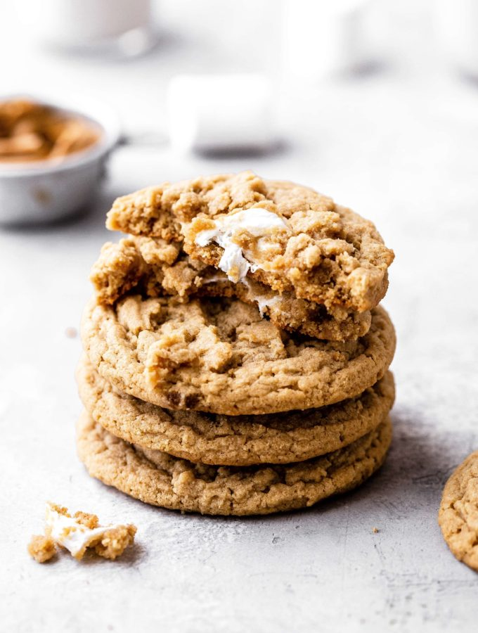 a stack of peanut butter cookies stuffed with marshmallow