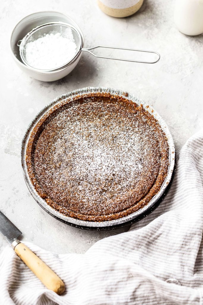a gooey butter cinnamon pie with powdered sugar on top