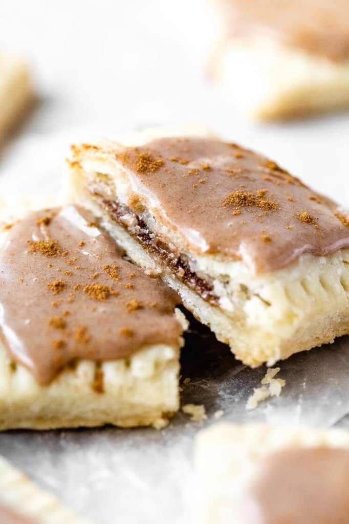 a homemade brown sugar cinnamon pop tart cut in half