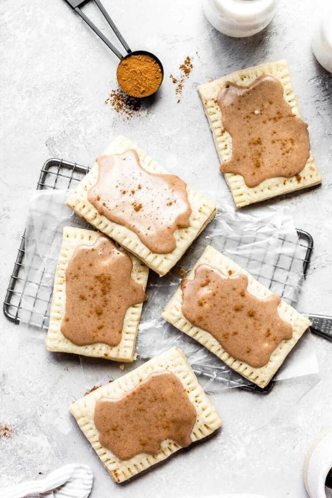 homemade brown sugar cinnamon pop tarts scattered on a wire rack