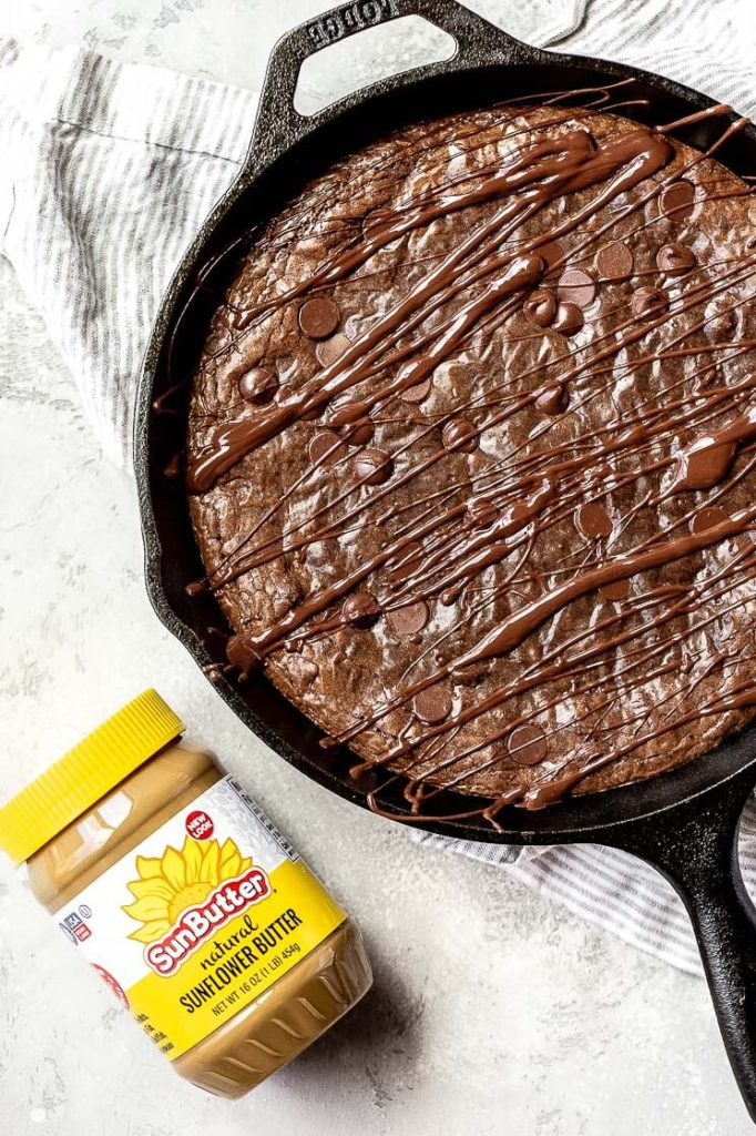 a freshly baked skillet brownie with its secret ingredient