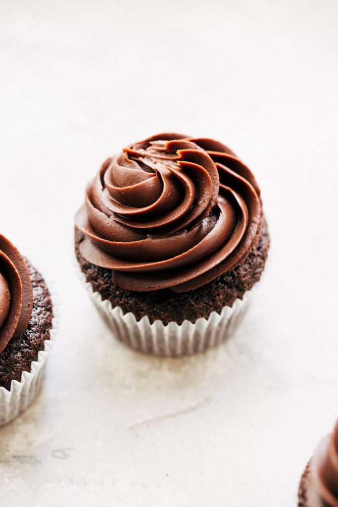 a gluten free chocolate cupcake with swirled chocolate ganache frosting