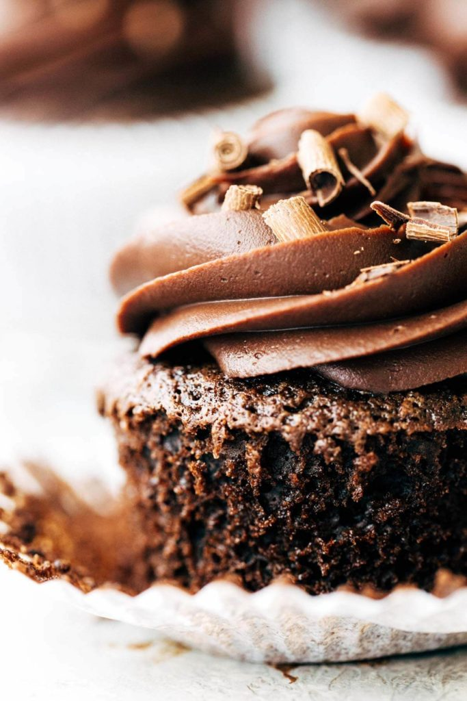 close up on a chocolate cupcake with chocolate curls on top