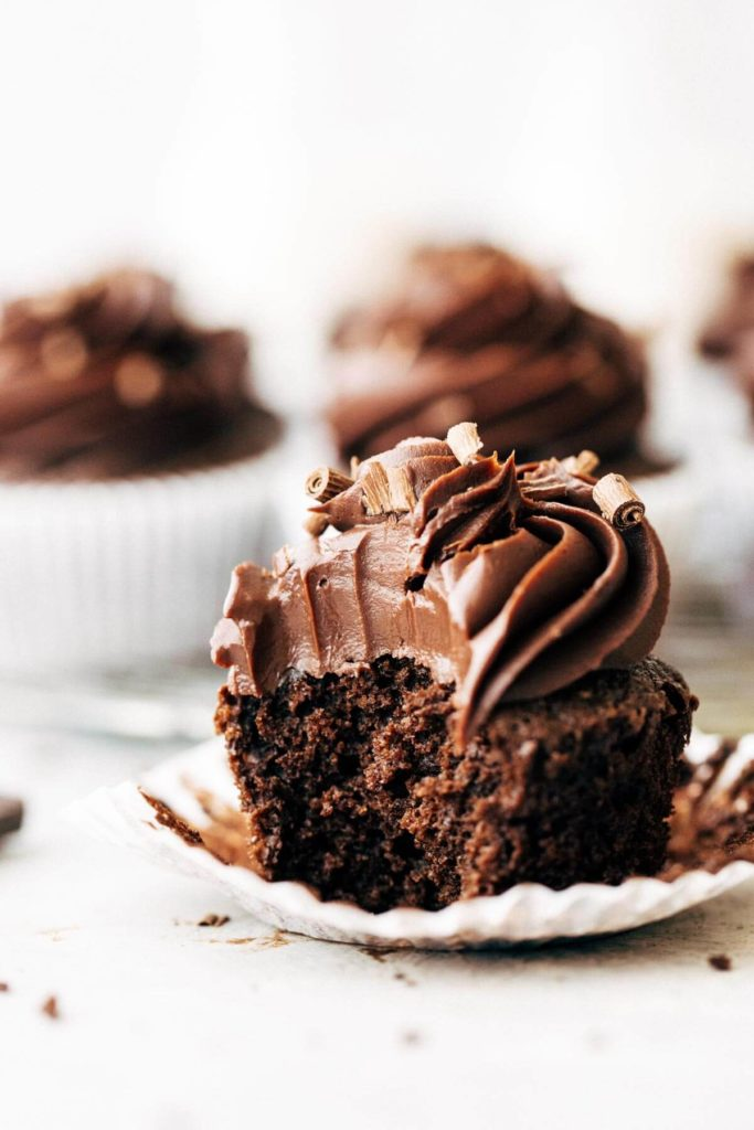 gluten free chocolate cupcake with a bite taken out