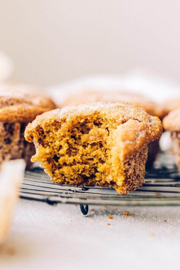 a bite taken out of a gluten free pumpkin muffin
