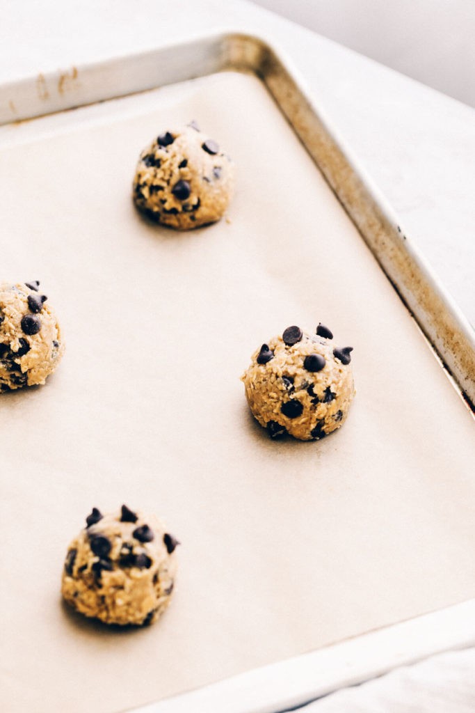 a baking tray of cookie dough about to go in the oven