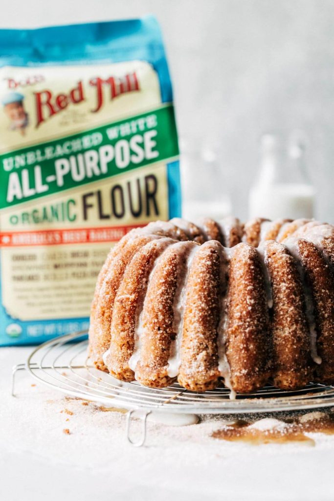 apple cider cake next to a bag of flour
