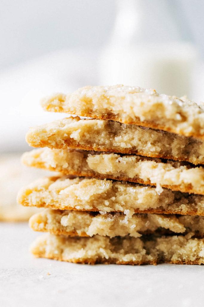 a stack of sugar cookies broken in half