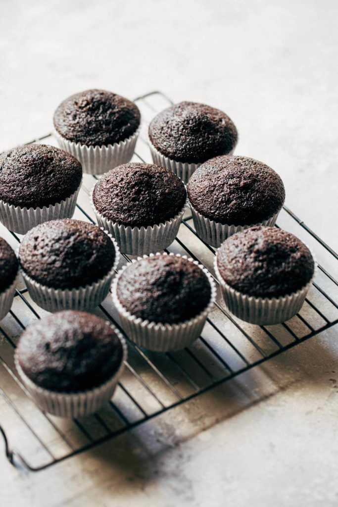 baked chocolate cupcakes on a cooling rack