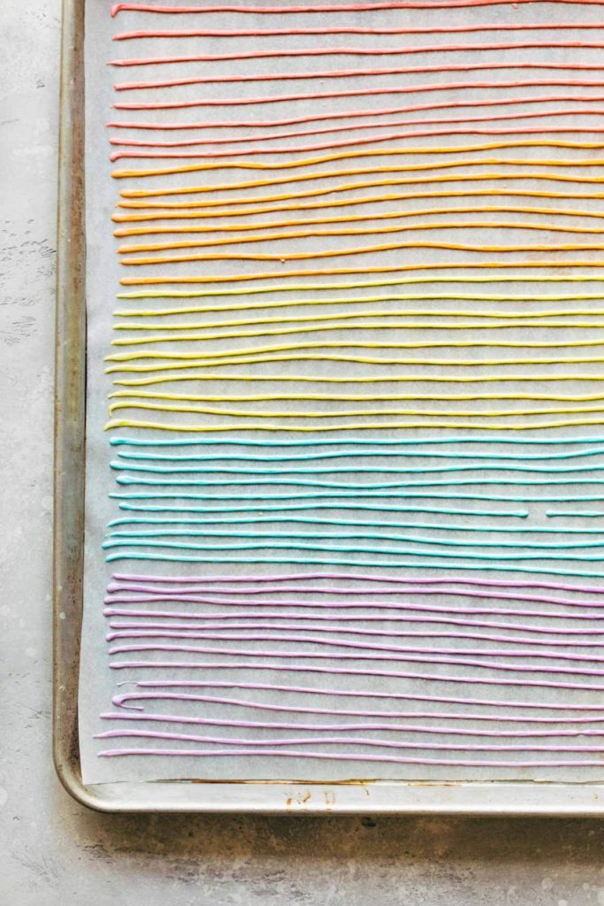 rows of homemade sprinkles on parchment paper