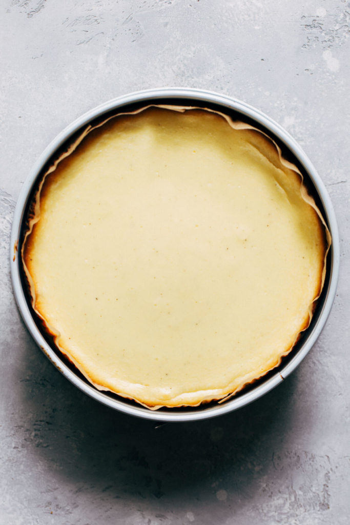 a freshly baked cheesecake still in the pan