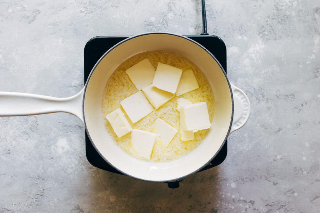 pads of butter melting in a saucepan