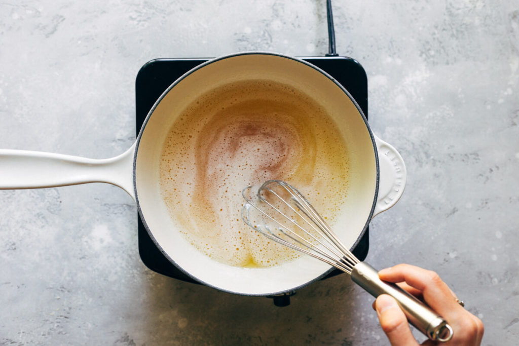 whisking brown butter in a sauce pan