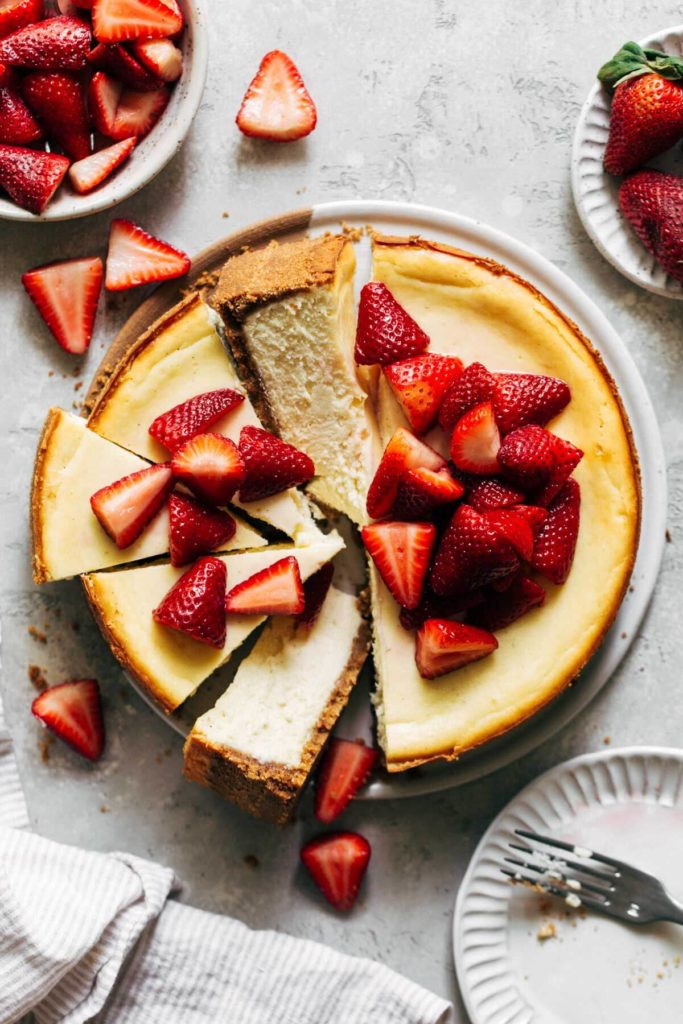 a whole cheesecake sliced into