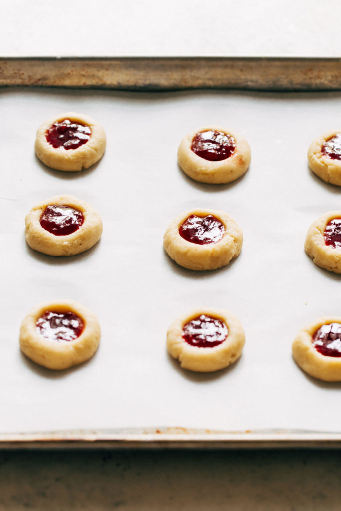 shortbread cookies filled with strawberry jam ready for baking