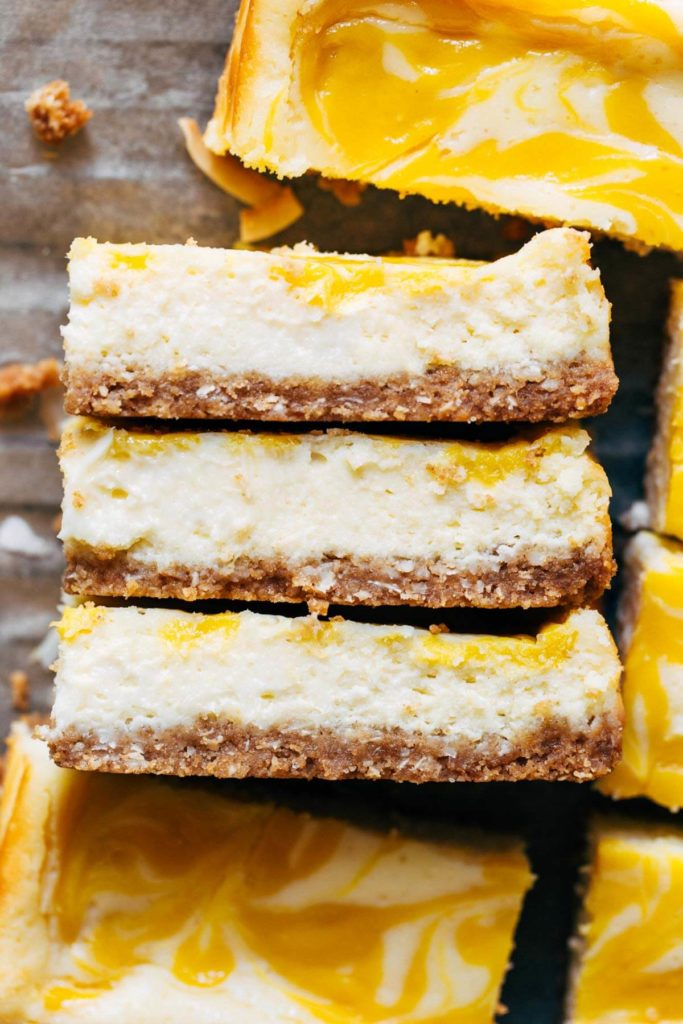 close up on three slices of coconut cheesecake bars