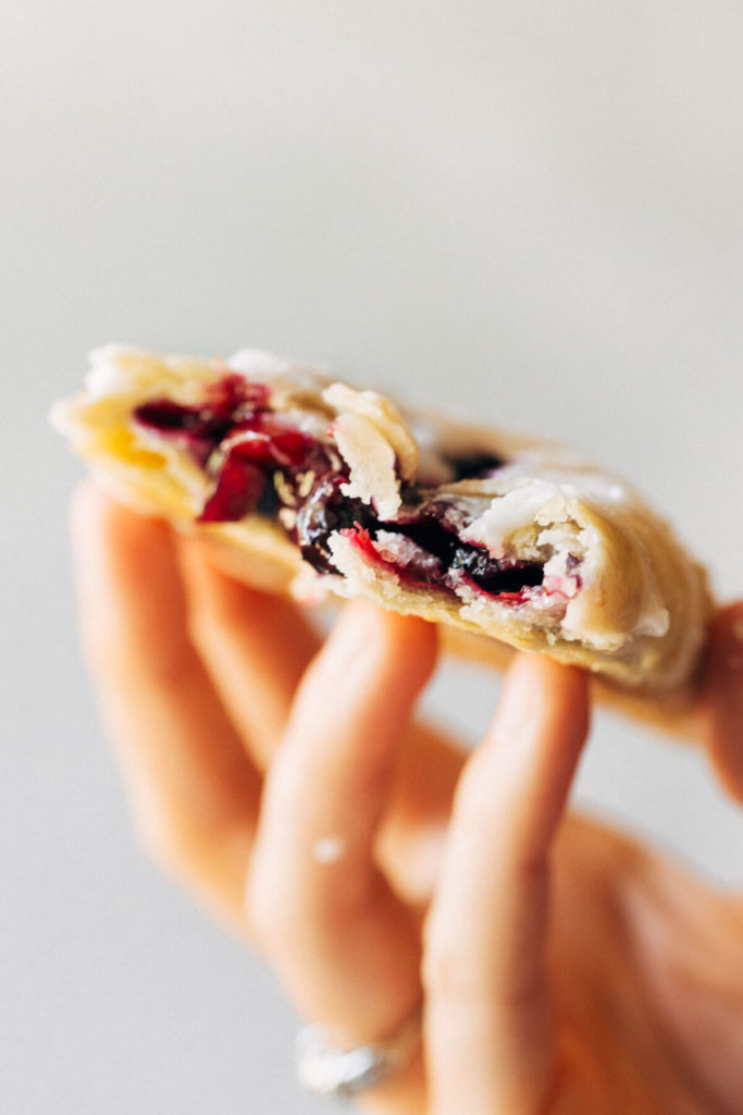 holding a blueberry hand pie
