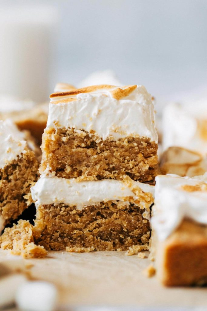 a stack of two peanut butter cookie bars topped with marshmallow meringue