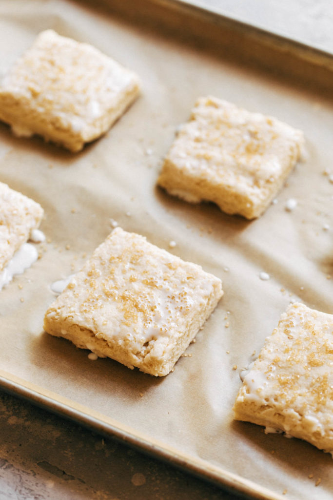 biscuit dough cut and placed on a baking sheet