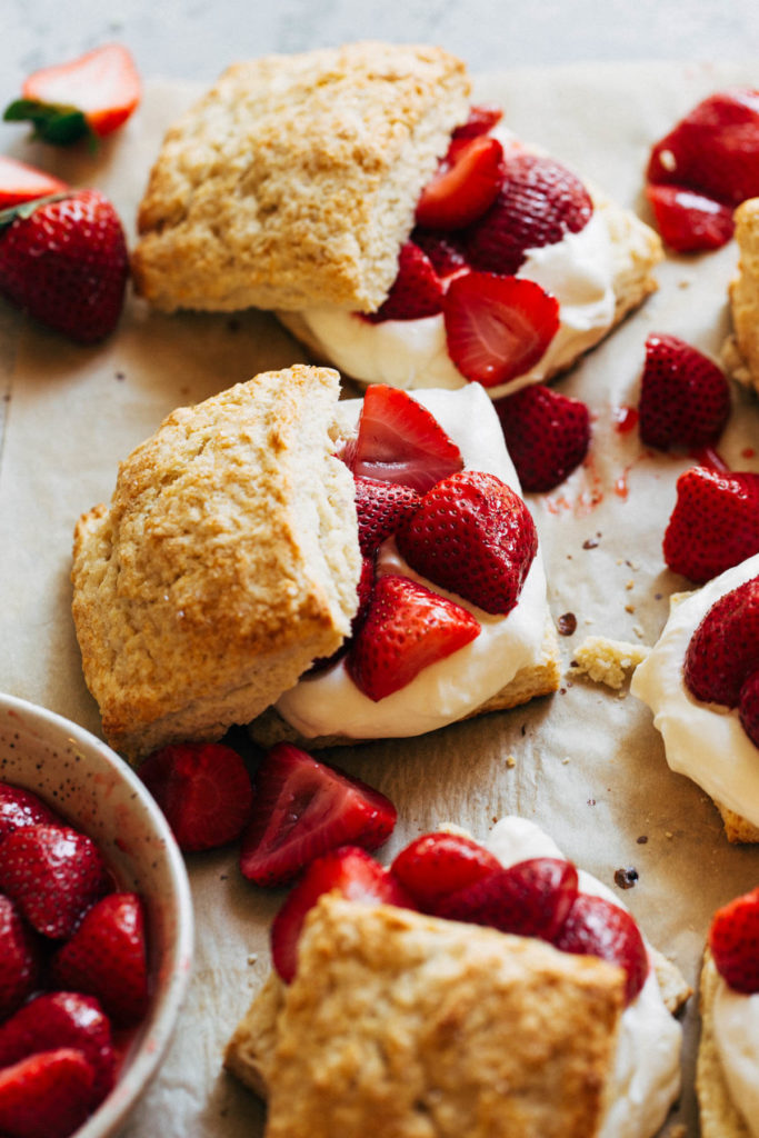 strawberry shortcakes scattered on parchment paper