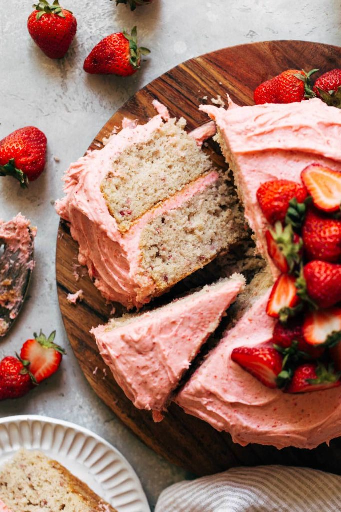 a slice of strawberry cake laying on its side