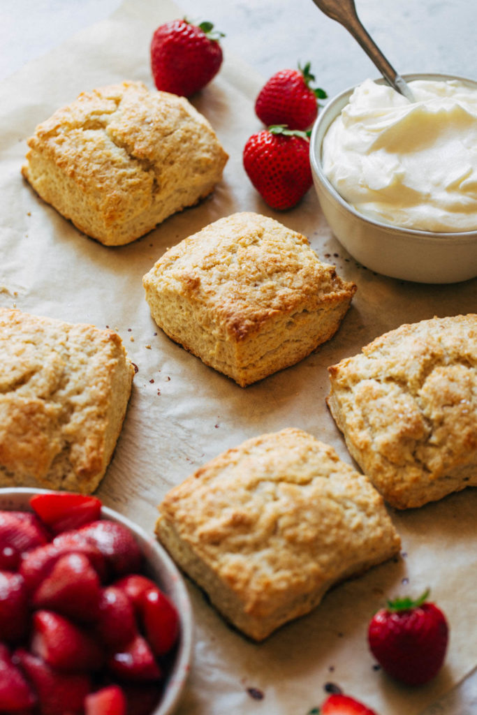 buttermilk biscuits scattered on parchment paper