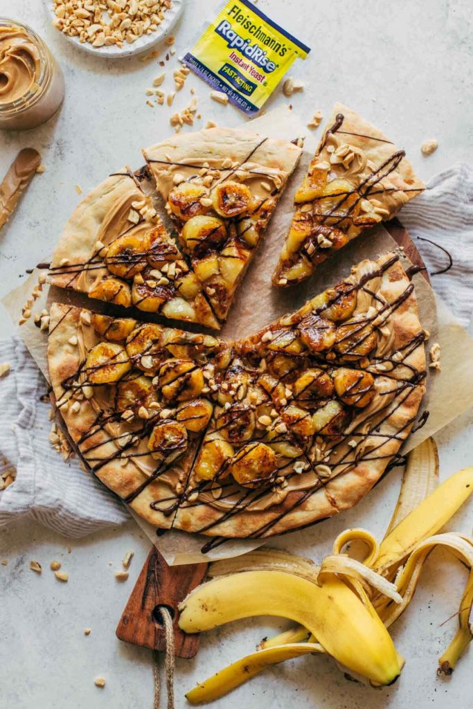 caramelized banana pizza on a wood board
