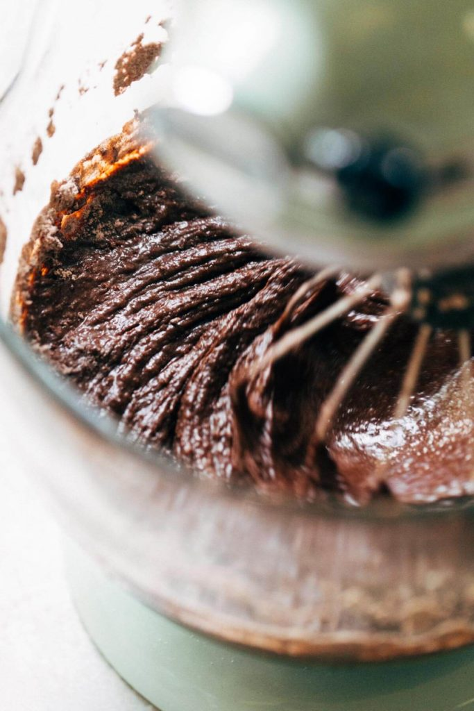 chocolate cake batter mixing in an electric mixer