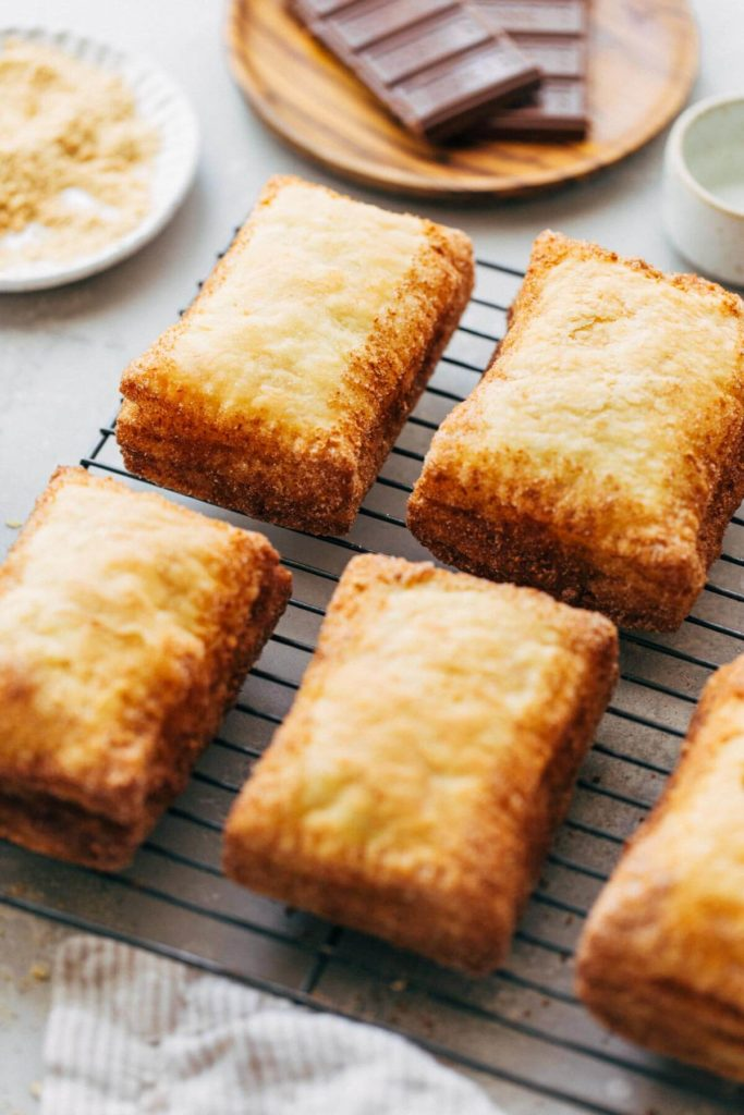 close up on the edges of puff pastry pop tarts coated with cinnamon sugar