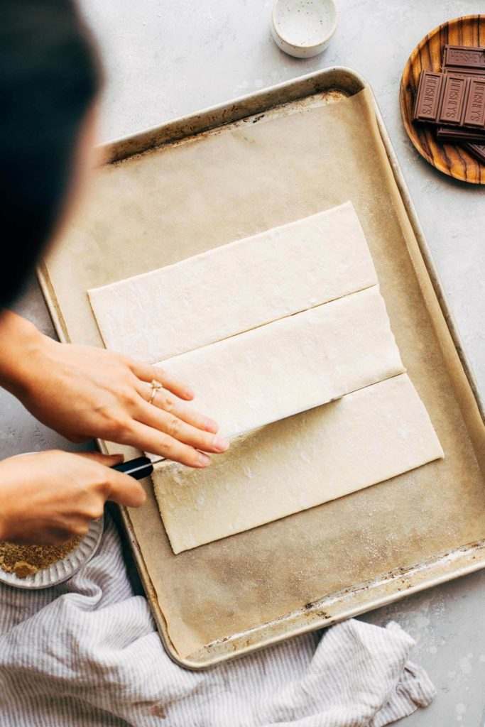 cutting a sheet of puff pastry into rectangles