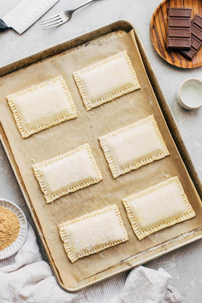 mini puff pastry pop tarts with the edges crimped