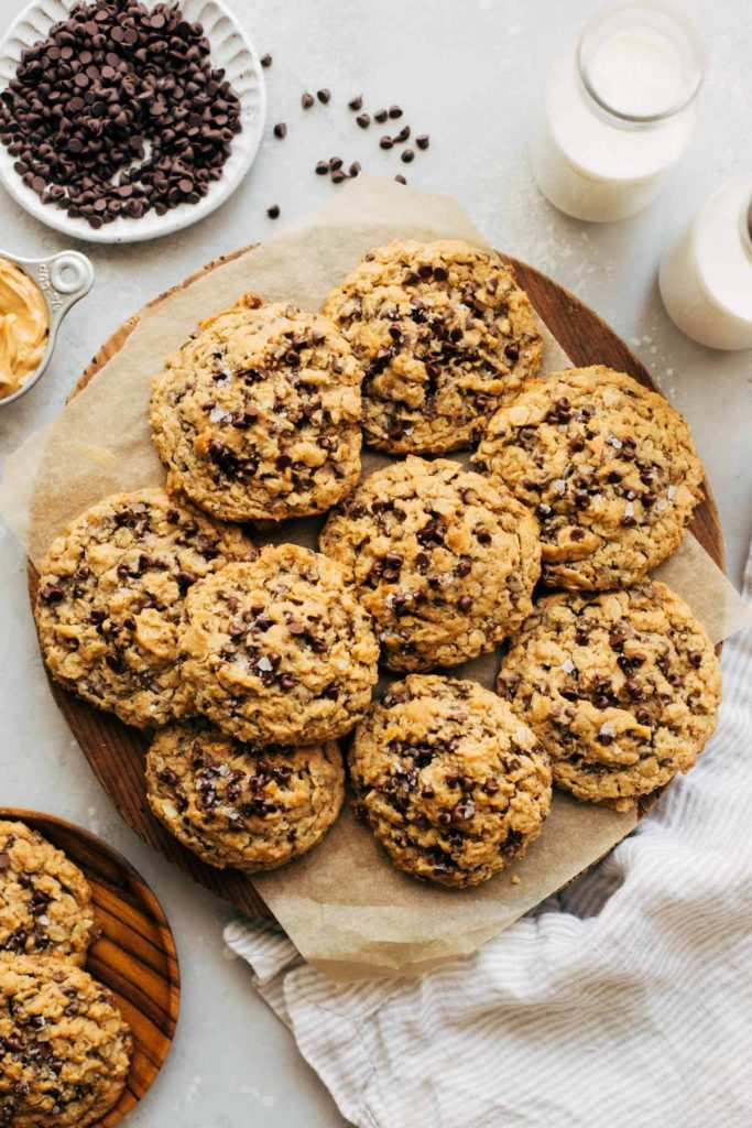 a round serving platter full of oatmeal chocolate chip cookies