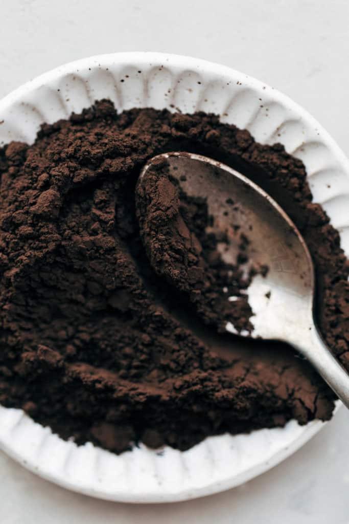 a dish of black cocoa powder