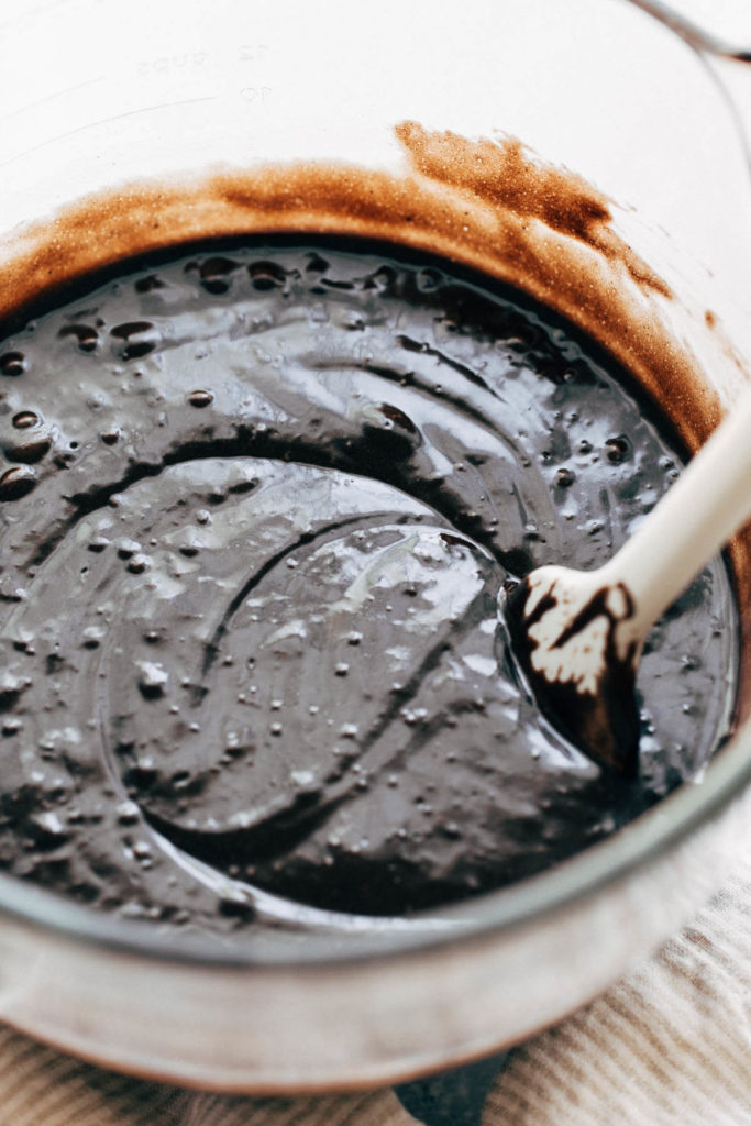 a bowl of black velvet cake batter