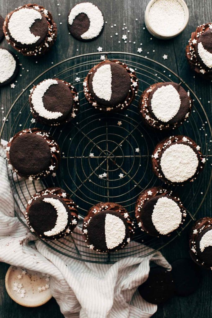 top view of brownie cupcakes arranged in a circle to display the phases of the moon