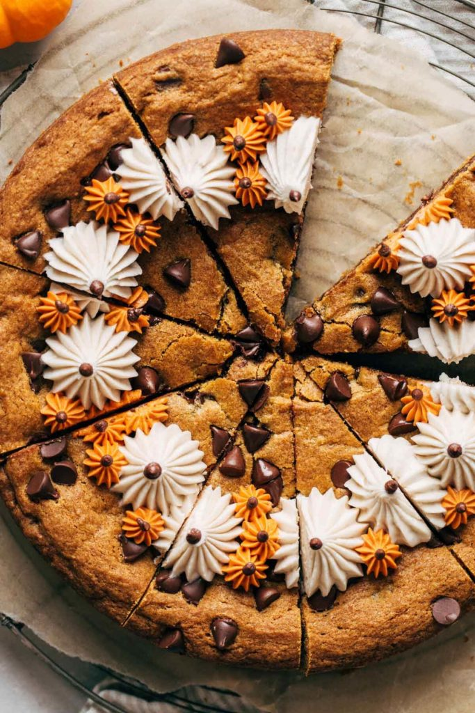 close up on the top of a sliced pumpkin cookie cake