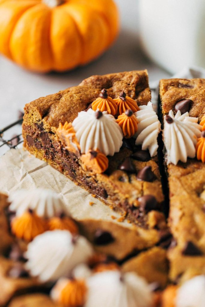 close up on a slice of pumpkin chocolate chip cookie cake