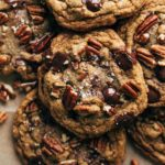 close up on the top of a butter pecan cookie with melty chocolate chips