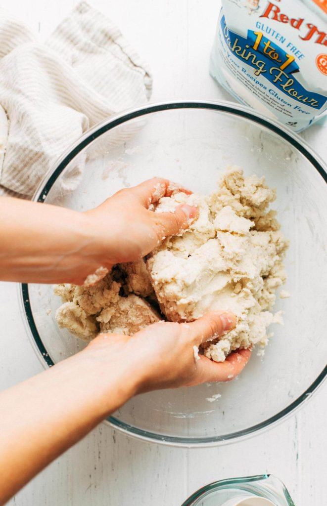 working together gluten free pie dough with hands