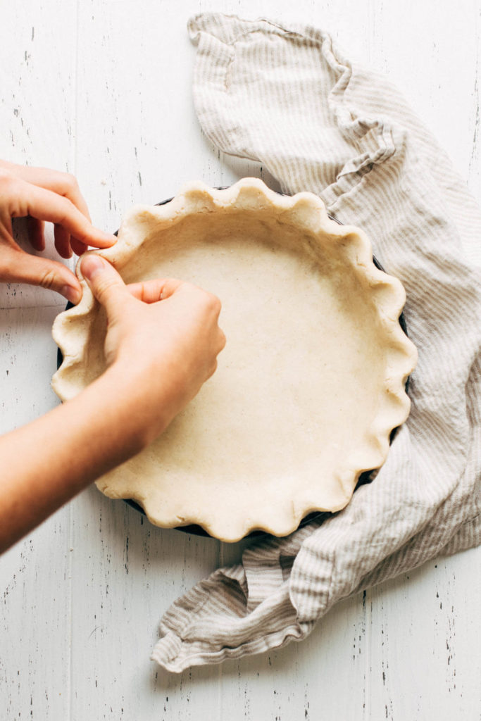 crimping the edges of a gluten free pie crust