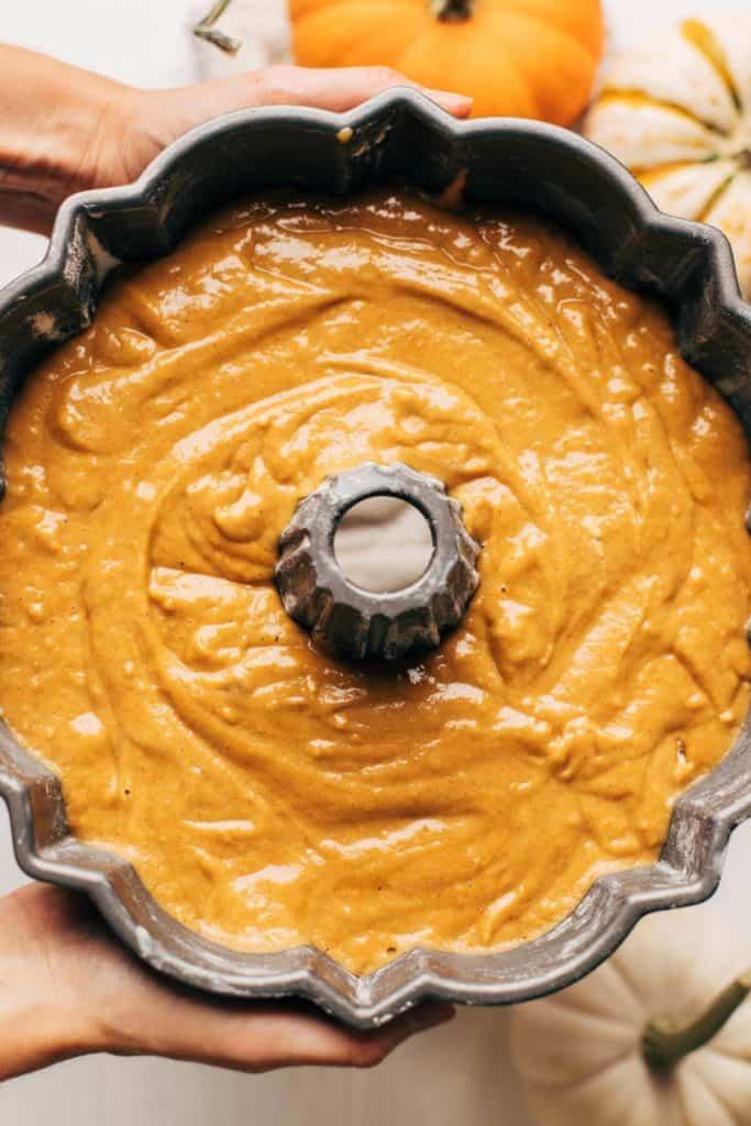 a bundt pan filled with pumpkin cake batter