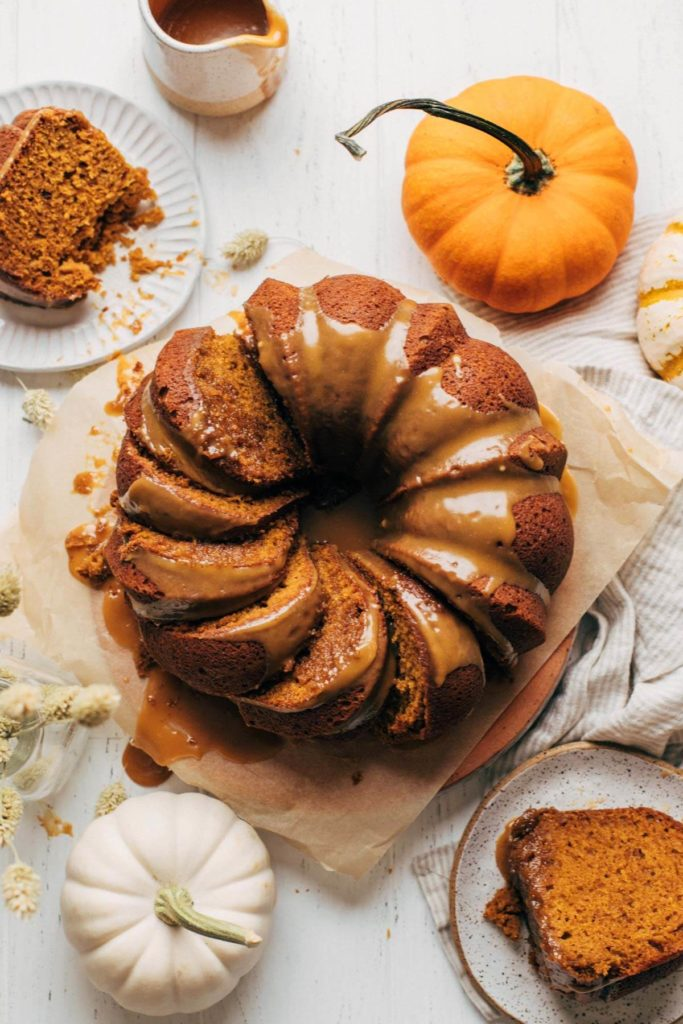 top view of a pumpkin bundt cake with slices laying on their sides