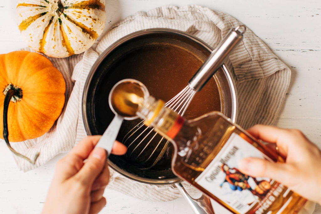 pouring rum into butterscotch sauce