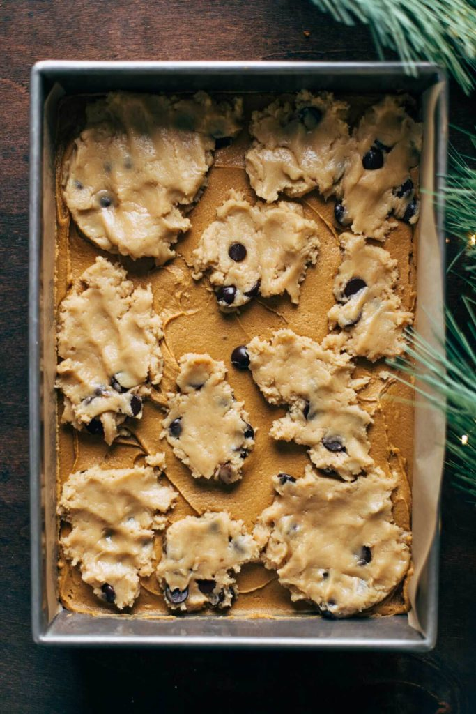 globs of cookie dough pressed into the surface of gingerbread dough